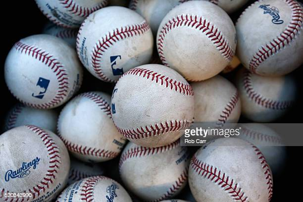 Baseballs sit in a bucket during the first inning of the Baltimore Orioles and Tampa Bay Rays game at Oriole Park at Camden Yards on April 10 2016 in...