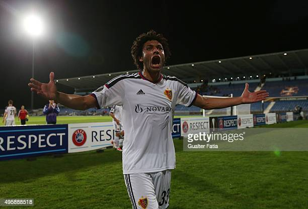 Basel 1893's midfielder Mohamed Elneny celebrates at the end of the UEFA Europa League match between Os Belenenses and FC Basel 1893 at Estadio do...