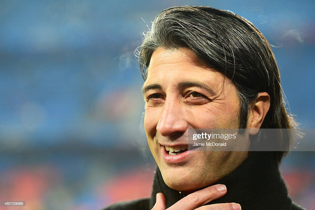 Basel Coach <a gi-track='captionPersonalityLinkClicked' href=/galleries/search?phrase=Murat+Yakin&family=editorial&specificpeople=2383035 ng-click='$event.stopPropagation()'>Murat Yakin</a> smiles during the UEFA Champions League Group E match between FC Basel 1893 and Chelsea at St. Jakob-Park on November 26, 2013 in Basel, Switzerland.