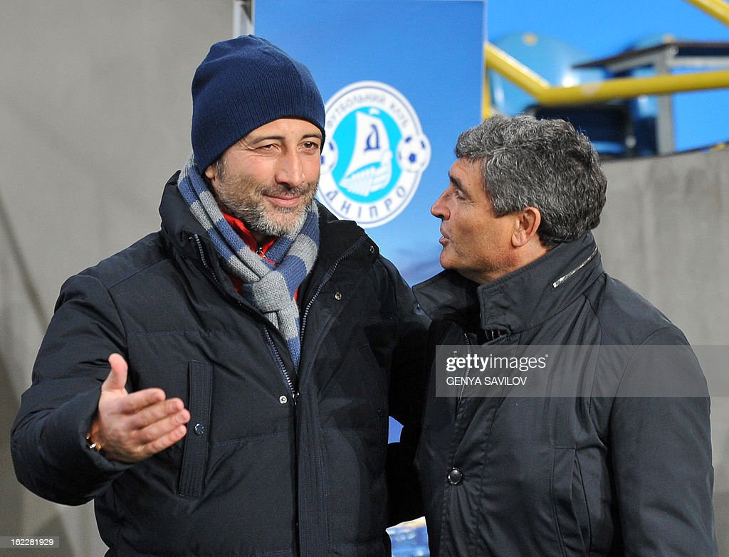 Basel coach Murat Yakin (L) speaks to FC Dnipro coach Juande Ramos (R) before UEFA Europa League, Round 32, football match of FC Dnipro against Basel in Dnipropetrovsk on February 21, 2013. AFP PHOTO/ GENYA SAVILOV
