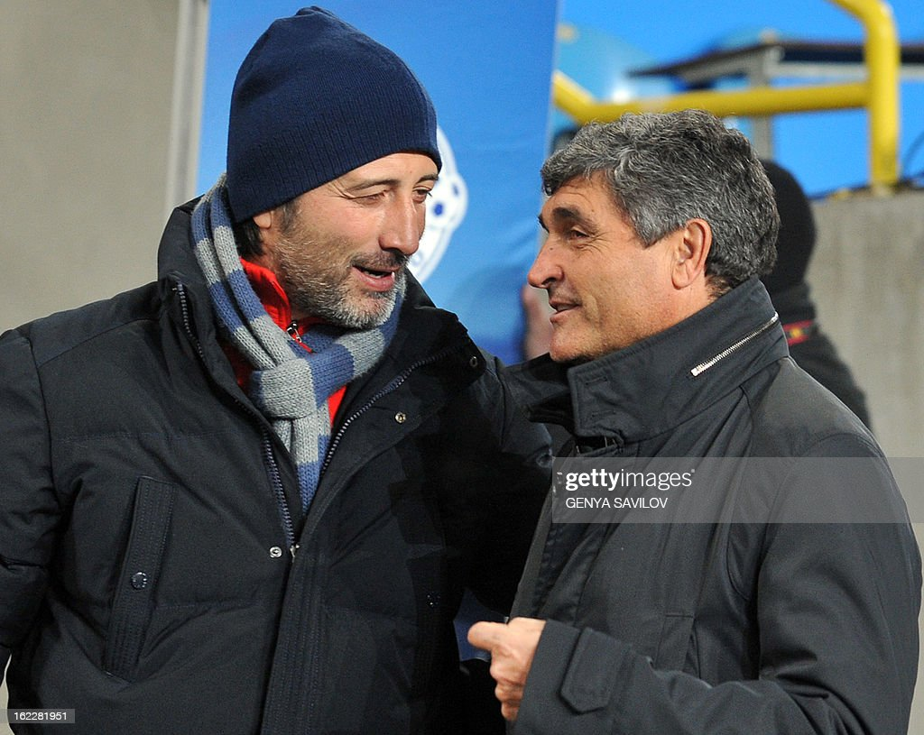 Basel coach Murat Yakin (L) speaks to FC Dnipro coach Juande Ramos before the UEFA Europa League, Round 32, football match of FC Dnipro against Basel in Dnipropetrovsk on February 21, 2013. AFP PHOTO/ GENYA SAVILOV