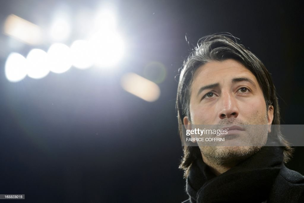 FC Basel coach Murat Yakin waits on March 7, 2013 before the start of a UEFA Europa League round of 16 first leg football match against Zenit St. Petersburg in Basel. AFP PHOTO / FABRICE COFFRINI