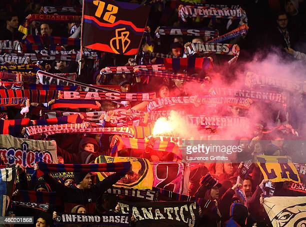 Basel fans cheer on their team during the UEFA Champions League group B match between Liverpool and FC Basel 1893 at Anfield on December 9 2014 in...