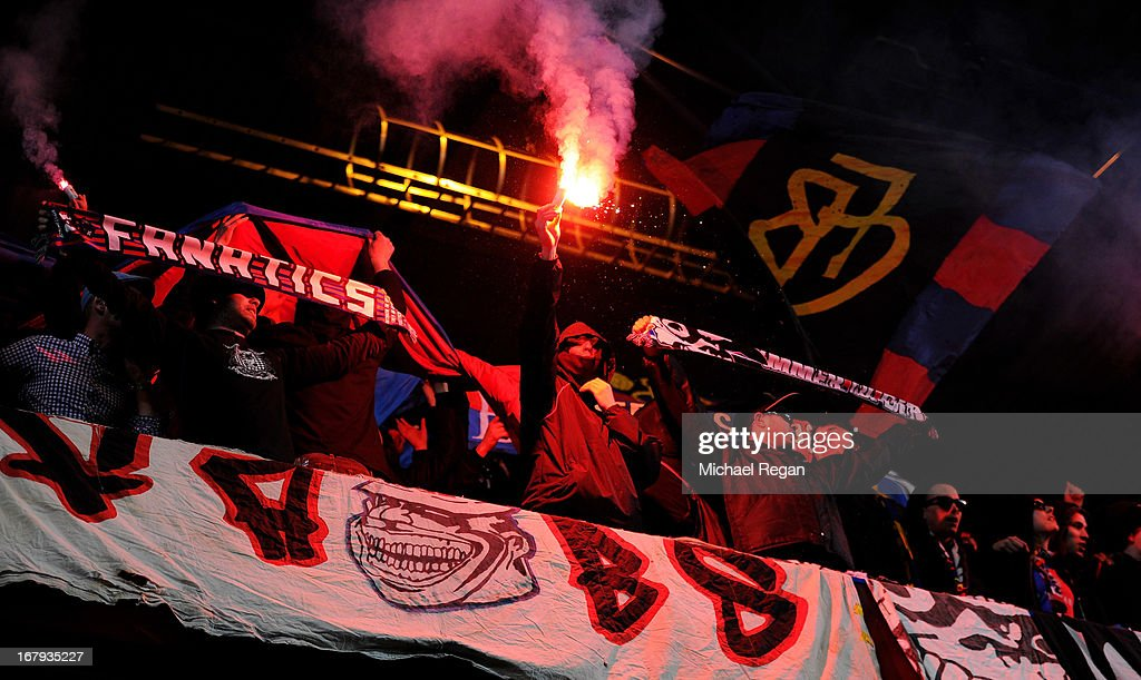 Basel fans cheer on their team whilst lighting flares during UEFA Europa League semi final second leg match between Chelsea and FC Basel 1893 at Stamford Bridge on May 2, 2013 in London, England.