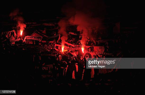 Basel fans light flares in support of their team prior the UEFA Champions League Group C match between Manchester United and FC Basel at Old Trafford...