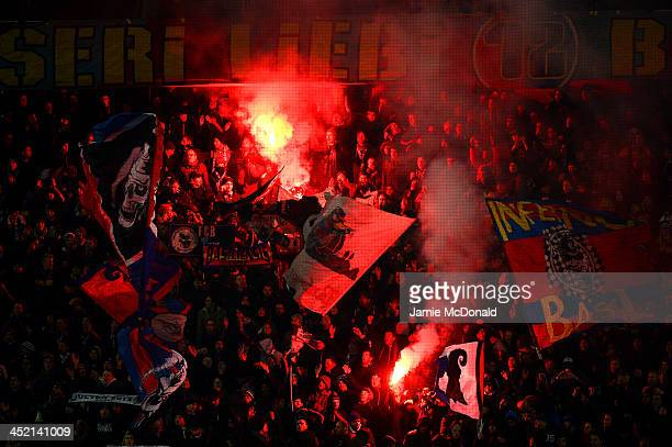 Basel fans set off flares during the UEFA Champions League Group E match between FC Basel 1893 and Chelsea at St JakobPark on November 26 2013 in...