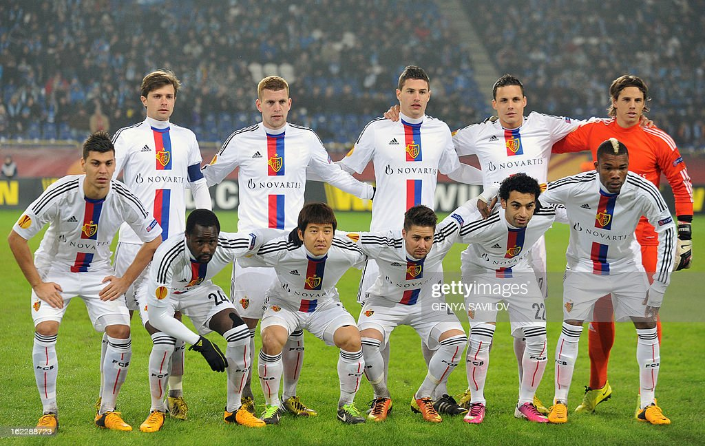Basel FC's starting lineup pose for a photo before their UEFA Europa League, Round 32, football match against FC Dnipro in Dnipropetrovsk on February 21, 2013. AFP PHOTO/ GENYA SAVILOV