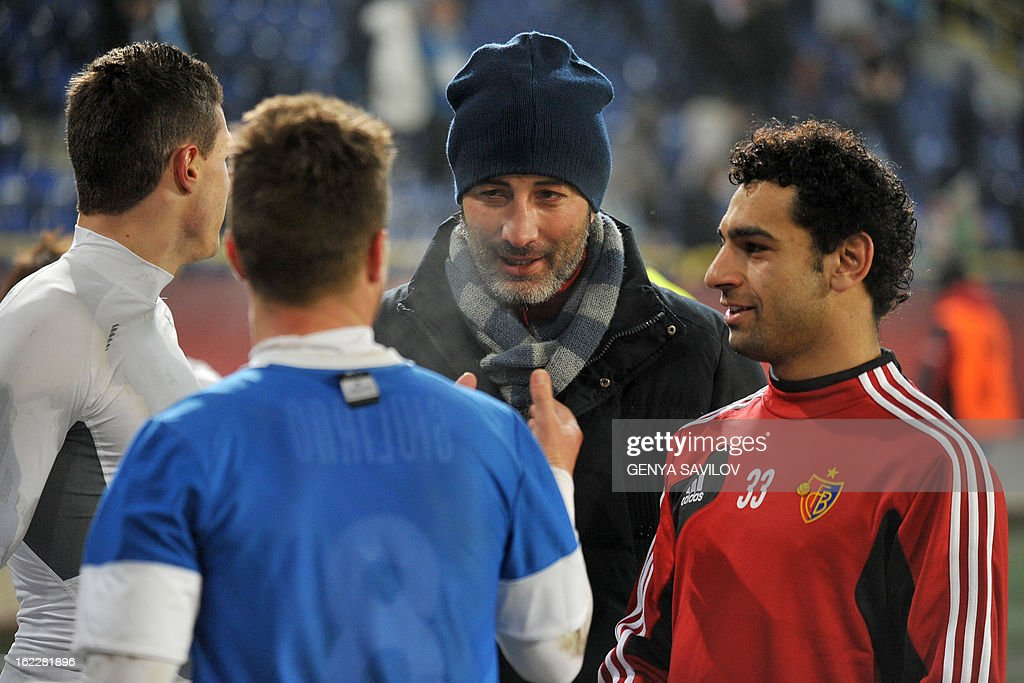 Basel head coach Murat Yakin (C) and players of FC Basel celebrate after their UEFA Europa League, Round 32, football match against FC Dnipro in Dnipropetrovsk on February 21, 2013. AFP PHOTO/ GENYA SAVILOV