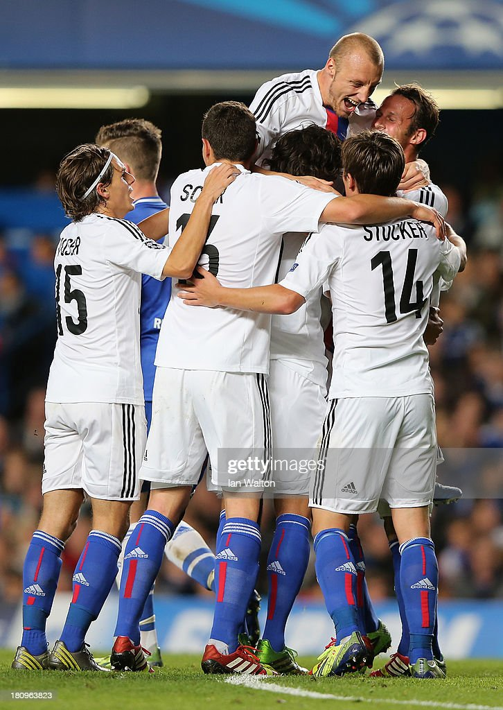 FC Basel players celebrate after Mohamed Salah of FC Basel scored their first goal during the UEFA Champions League Group E Match between Chelsea and FC Basel at Stamford Bridge on September 18, 2013 in London, England.