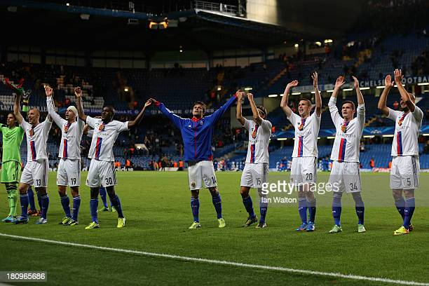 Basel players celebrate in front of their fans at the final whistle during the UEFA Champions League Group E Match between Chelsea and FC Basel at...