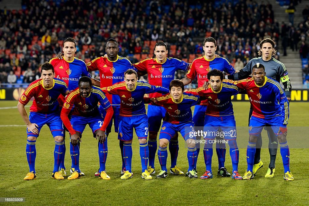 FC Basel players pose, from left, front row: Serbian defender Aleksandar Dragovic, midfielder Adilson Tavares Varela Cabral, midfielder Marcelo Diaz, South Korean defender Park Joo Ho, Egyptian midfielder Mohamed Salah and Ivorian midfielder Geoffroy Serey Die. Second row, from left: midfielder David Degen, Cameroonian forward Jacques Zoua, defender Philipp Degen, defender Fabian Schaer and goalkeeper Yann Sommer, before a UEFA Europa League round of 16 first leg football match between FC Basel and Zenit St. Petersburg on March 7, 2013 in Basel. AFP PHOTO / FABRICE COFFRINI