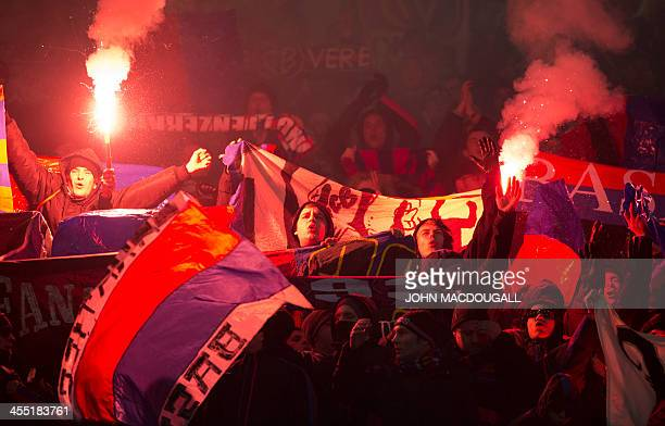 Basel supporters light flares at the end of the UEFA Champions League group E football match FC Schalke 04 vs FC Basel 1893 in Gelsenkirchen Germany...
