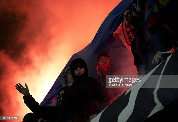 FC Basel supporters light flares during the Europa League semifinal second leg football match against Chelsea at Stamford Bridge in London on May 2...