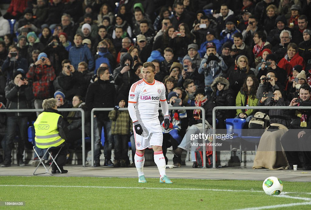 FC Basel supporters taking pictures of former player <a gi-track='captionPersonalityLinkClicked' href=/galleries/search?phrase=Xherdan+Shaqiri&family=editorial&specificpeople=6923918 ng-click='$event.stopPropagation()'>Xherdan Shaqiri</a> of Bayern Munich before he takes a corner kick during the friendly match between FC Basel and Bayern Munich at Stadium St. Jakob on January 12, 2013 in Basel, Switzerland.