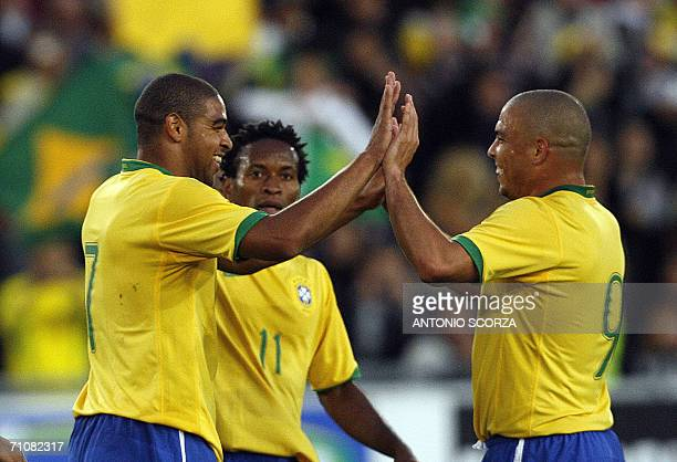 Brazilian footbaler Adriano celebrates their goal with teammate Ronaldo against FC Lucern Selection during a friendly match at St Jakob stadium in...