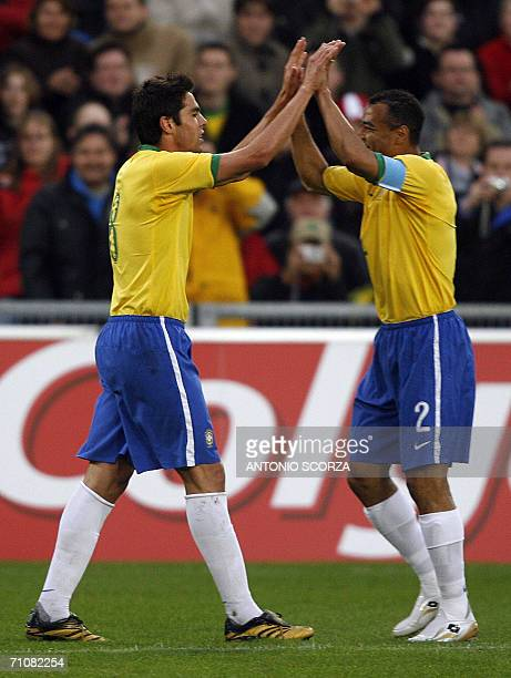 Brazilian footbaler Kaka celebrates their goal with teammate Cafu against FC Lucern Selection 30 May 2006 during a friendly match at St Jakob stadium...
