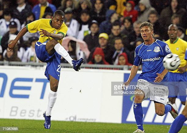 Brazilian footbaler Robinho kicks the ball to score a goal the seventh to Brazil against FC Lucern Selection during a friendly match at St Jakob...