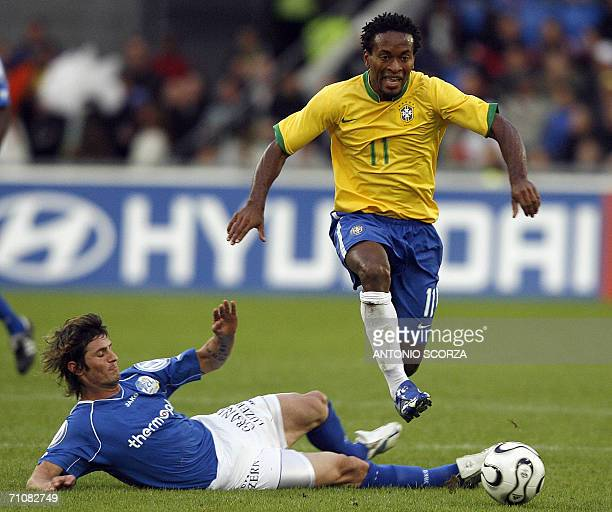 Brazilian footbaler Ze Roberto vies for the ball with Ivan del Santo of the FC Lucern Selection during a friendly match at St Jakob stadium in Basel...
