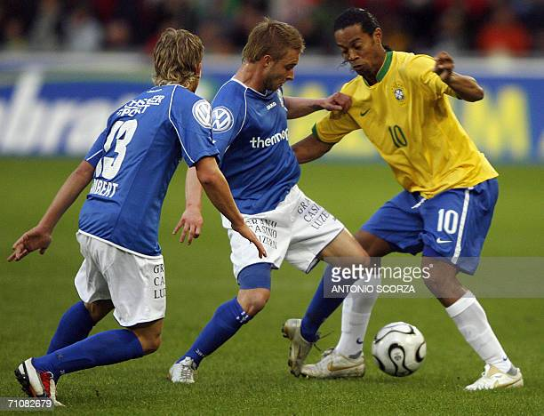 Brazilian Ronaldinho Gaucho vies for the ball with Christophe Lambert and Selim Boz of FC Lucern Selection during a friendly match at St Jakob...