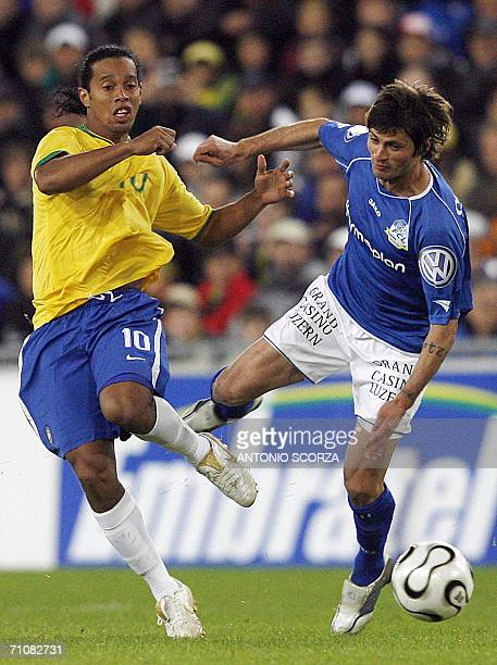 Brazilian Ronaldinho Gaucho vies for the ball with Marco Sucic of the FC Lucern Selection during a friendly match at St Jakob stadium in Basel 30 May...