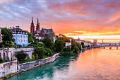 Basel, Switzerland.  Old town with Munster cathedral on the Rhine river at sunset.