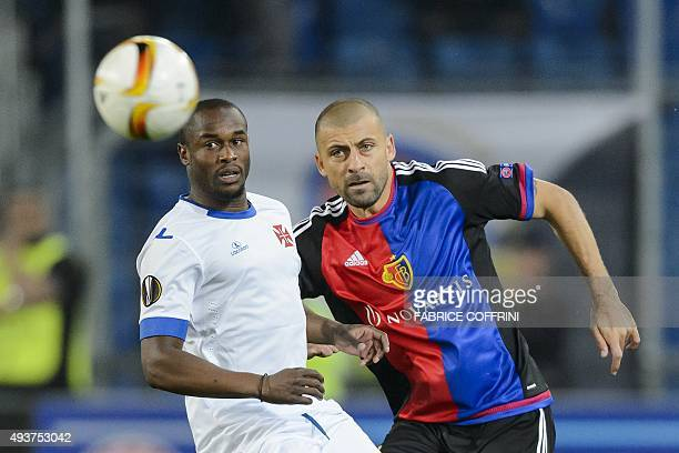 Basel's Argentine defender Walter Samuel vies with Belenenses' Portugese forward Luis Leal during the UEFA Europa League group I football match...