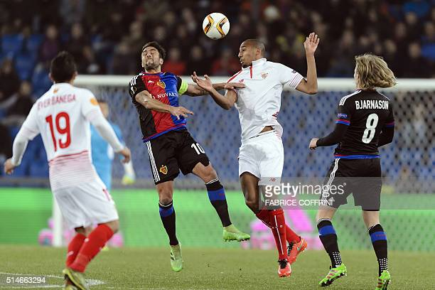 Basel's Argentine midfielder Matias Delgado vies with Sevilla's French midfielder Steven N'Zonzi vies during the UEFA Europa League round of 16 first...