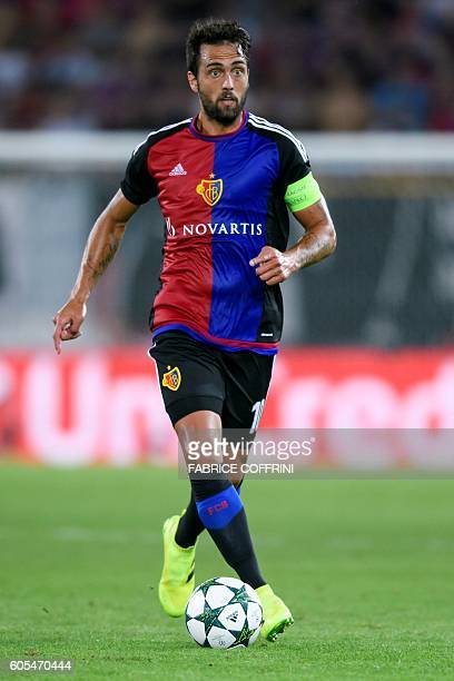 Basel's Argentinian midfielder Matias Delgado controls the ball during the UEFA Champions League group A football match beetween FC Basel 1893 and...