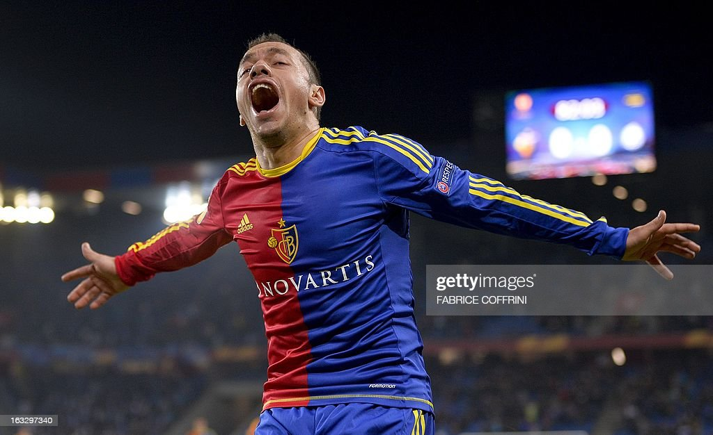 FC Basel's Chilean midfielder Marcelo Diaz celebrates after he scored his team's first goal during the UEFA Europa League round of 16 first leg football match between FC Basel and Zenit St. Petersburg on March 7, 2013 in Basel. AFP PHOTO / FABRICE COFFRINI