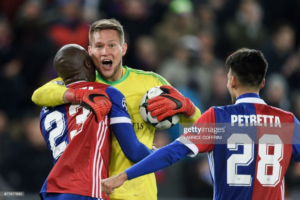 Basel's Czech goalkeeper Tomas Vaclik (C) celebrates with teammates Colombian defender Eder Balanta (L) and Italian defender Raoul Petretta (R) after winning at the end of the UEFA Champions League Group A football match between FC Basel and Manchester United on November 22, 2017 in Basel. / AFP PHOTO / Fabrice COFFRINI