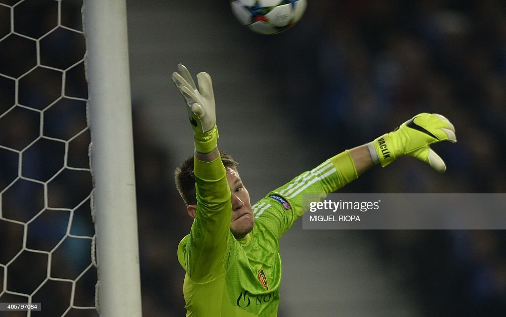 Basel's Czech goalkeeper <a gi-track='captionPersonalityLinkClicked' href=/galleries/search?phrase=Tomas+Vaclik&family=editorial&specificpeople=5437912 ng-click='$event.stopPropagation()'>Tomas Vaclik</a> fails to stop the third goal scored by Porto during the UEFA Champions League round of 16 second leg football match FC Porto vs FC Basel at the Dragao stadium in Porto on March 10, 2015. Porto won the match 4-0.