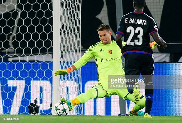 Basel's Czech goalkeeper Tomas Vaclik tries to stop a goal during the UEFA Champions League group A football match between FC Basel and PFC...