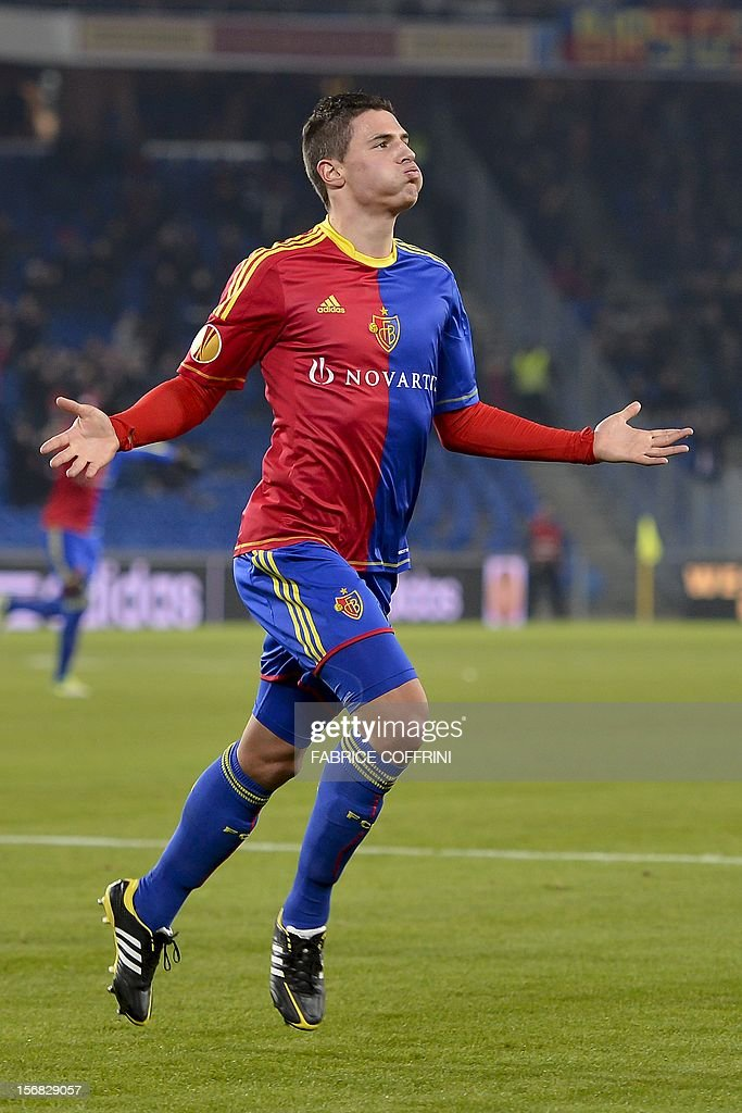 FC Basel's defender Fabian Schaer celebrates after scoring his team's first goal during the Europa League UEFA Group G football match between FC Basel and Sporting Clube de Portugal on November 22, 2012, in Basel.