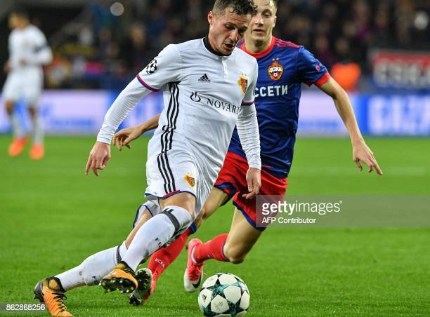 Basel's defender from Albania Taulant Xhaka and CSKA Moscow's midfielder from Russia Aleksandr Golovin vie for the ball during the UEFA Champions...
