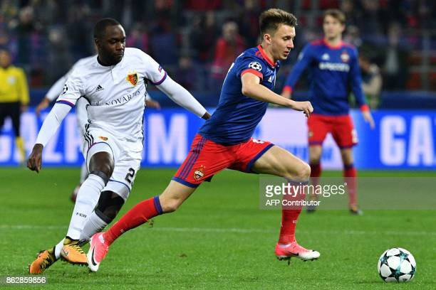 Basel's defender from Colombia Eder Alvarez Balanta and CSKA Moscow's midfielder from Russia Aleksandr Golovin vie for the ball during the UEFA...