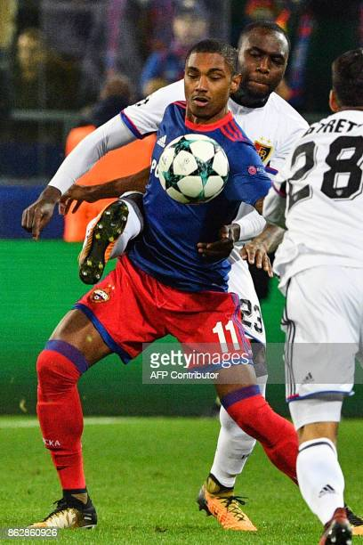 Basel's defender from Colombia Eder Alvarez Balanta and CSKA Moscow's forward from Brazil Vitinho vie for the ball during the UEFA Champions League...