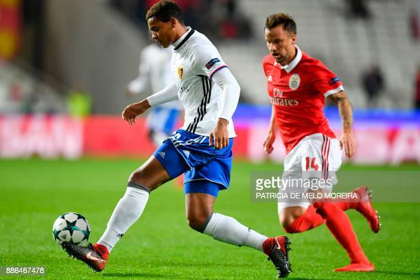 Basel's defender Manuel Akanji challenges Benfica's Swiss forward Haris Seferovic during the UEFA Champions League football match SL Benfica vs FC...