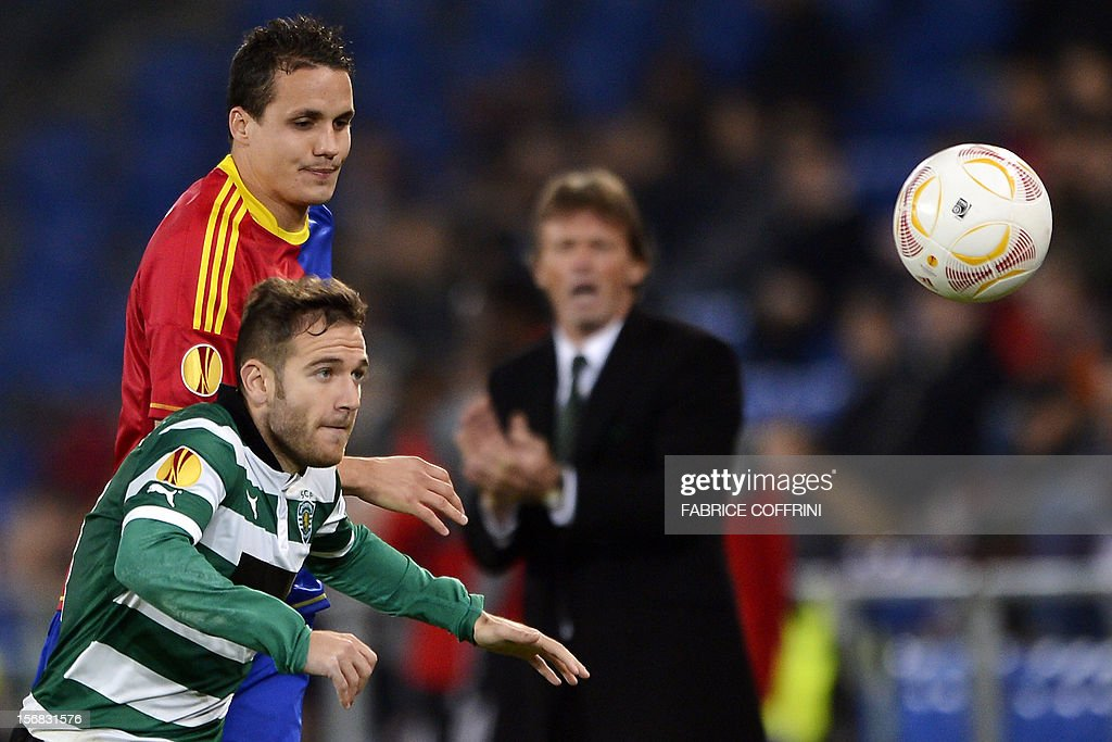 FC Basel's defender Philipp Degen (Top L) vies for the ball with Sporting's Spanish midfielder Diego Capel (Bottom L) during the Europa League UEFA Group G football match between FC Basel and Sporting Clube de Portugal on November 22, 2012, in Basel.