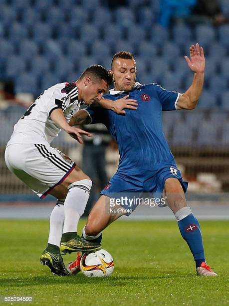 Basel's defender Taulant Xhaka vies for the ball with Belenenses's midfielder Andre Sousa during the UEFA Europa League football match between CF...