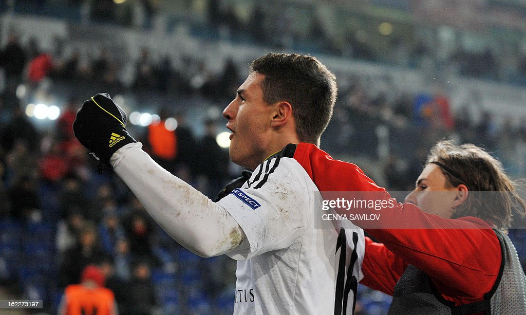 Basel's Fabian Schar celebrates after scoring a goal against Dnipro during an UEFA Europa League round of 32 football match in Dnipropetrovsk on February 21, 2013. AFP PHOTO/ GENYA SAVILOV