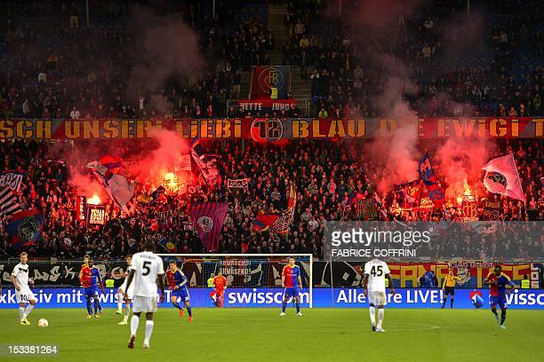 FC Basel's fans light flares after their team scored during the UEFA Europa League group G football match FC Basel vs KRC Genk on October 4 2012 in...