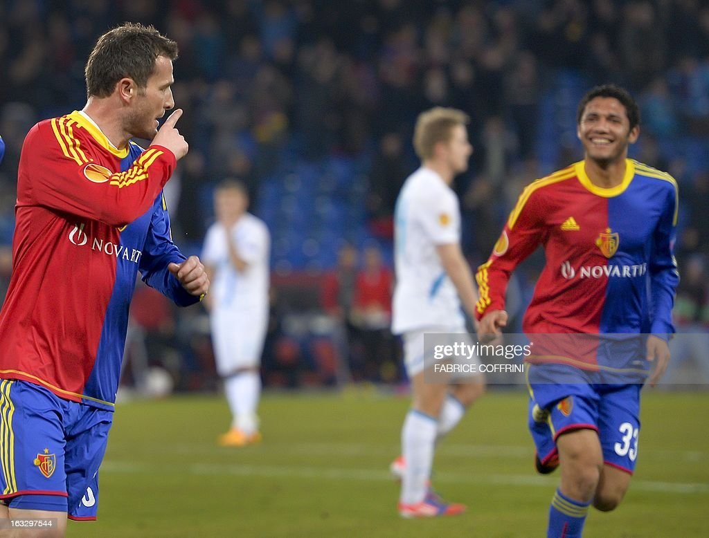 FC Basel's forward Alexander Frei (C) celebrates next to teammate Egyptian midfielder Mohamed Elneny (R) after he scored his team's second goal by penalty during the UEFA Europa League round of 16 first leg football match between FC Basel and Zenit St. Petersburg on March 7, 2013 in Basel. AFP PHOTO / FABRICE COFFRINI