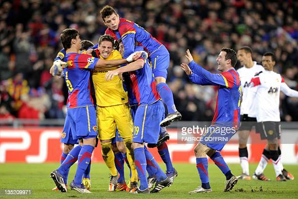 FC Basel's goalkeeper Yann Sommer and his teammates celebrates after they qualified during their UEFA Champions League group C football match against...