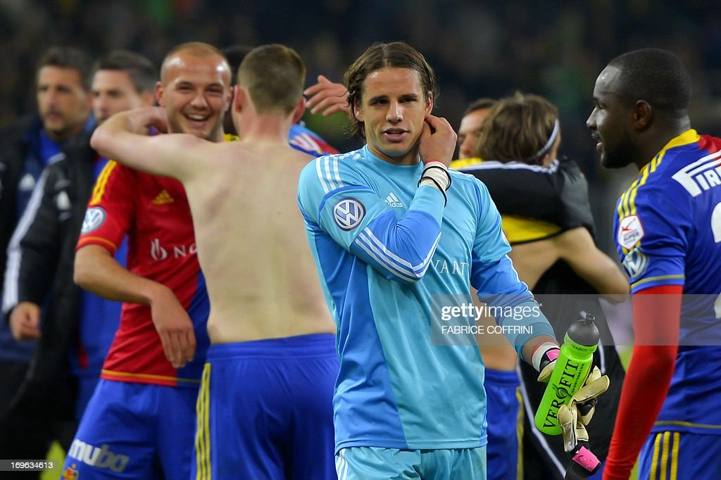 FC Basel's goalkeeper Yann Sommer (C) reacts after winning the Swiss football championship title after Basel won 1-0 their penultimate season's match against Bern Young Boys on May 29, 2013 in Bern.