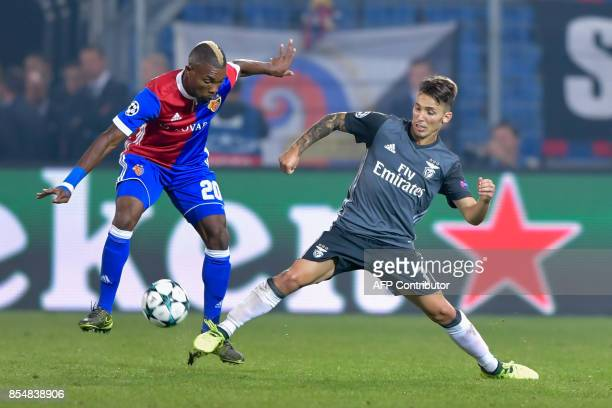 Basel's Ivorian midfielder Geoffroy Serey Die and Benfica's Spanish defender Alejandro Grimaldo fight for the ball during the UEFA Champions League...