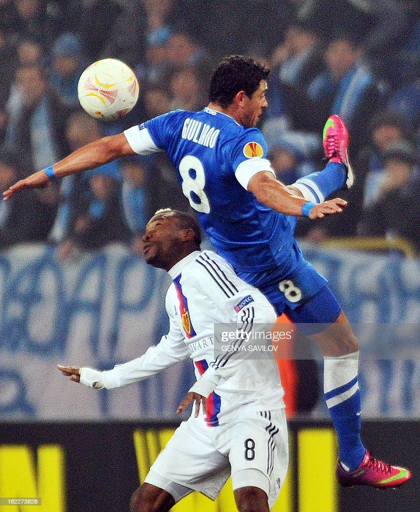 Basel's Ivorian midfielder Serey Die (L) fights for the ball with Dnipro Dnipropetrovsk's Brazilian midfielder Giuliano during the UEFA Europa League, Round 32, football match between Dniepr Dnipropetrovsk and FC Basel on February 21, 2013 in Dnipropetrovsk, Ukraine. AFP PHOTO/ GENYA SAVILOV