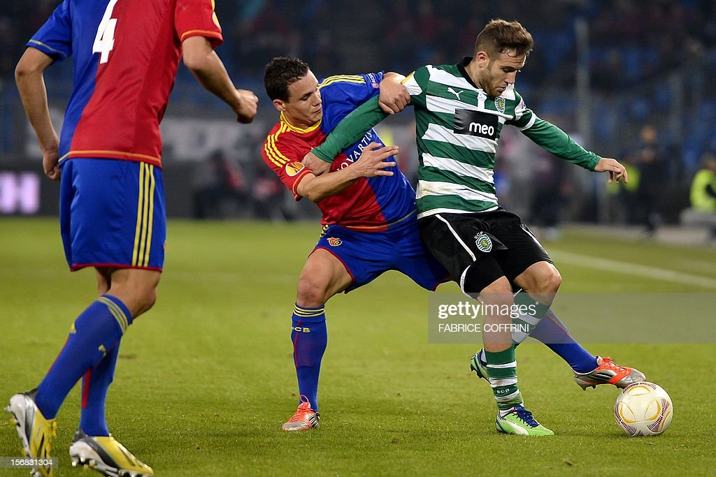 FC Basel's midfielder David Degen (C) vies for the ball with Sporting's Spanish midfielder Diego Capel during the Europa League UEFA Group G football match between FC Basel and Sporting Clube de Portugal on November 22, 2012, in Basel.