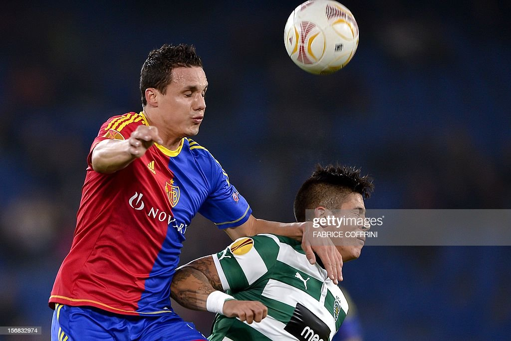 FC Basel's midfielder David Degen (L) vies for the ball with Sporting's Argentinian defender Marcos Rojo during the Europa League UEFA Group G football match between FC Basel and Sporting Clube de Portugal on November 22, 2012, in Basel. AFP PHOTO / FABRICE COFFRINI