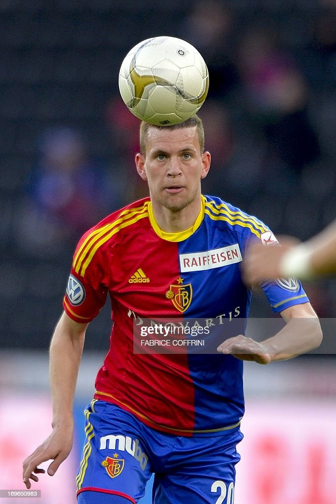 FC Basel's midfielder Fabian Frei eyes the ball on May 29, 2013 during a Swiss football Super League match against Bern Young Boys in Bern. AFP PHOTO / FABRICE COFFRINI