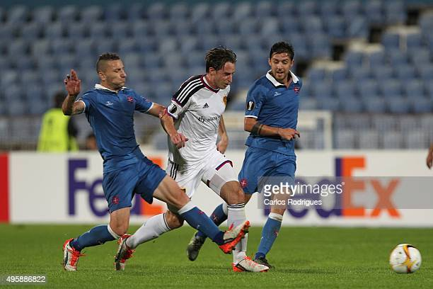Basel's midfielder Luca Zuffi vies with Belenenses's midfielder Andre Sousa during the match between Belenenses v Altach for the UEFA Europa League...
